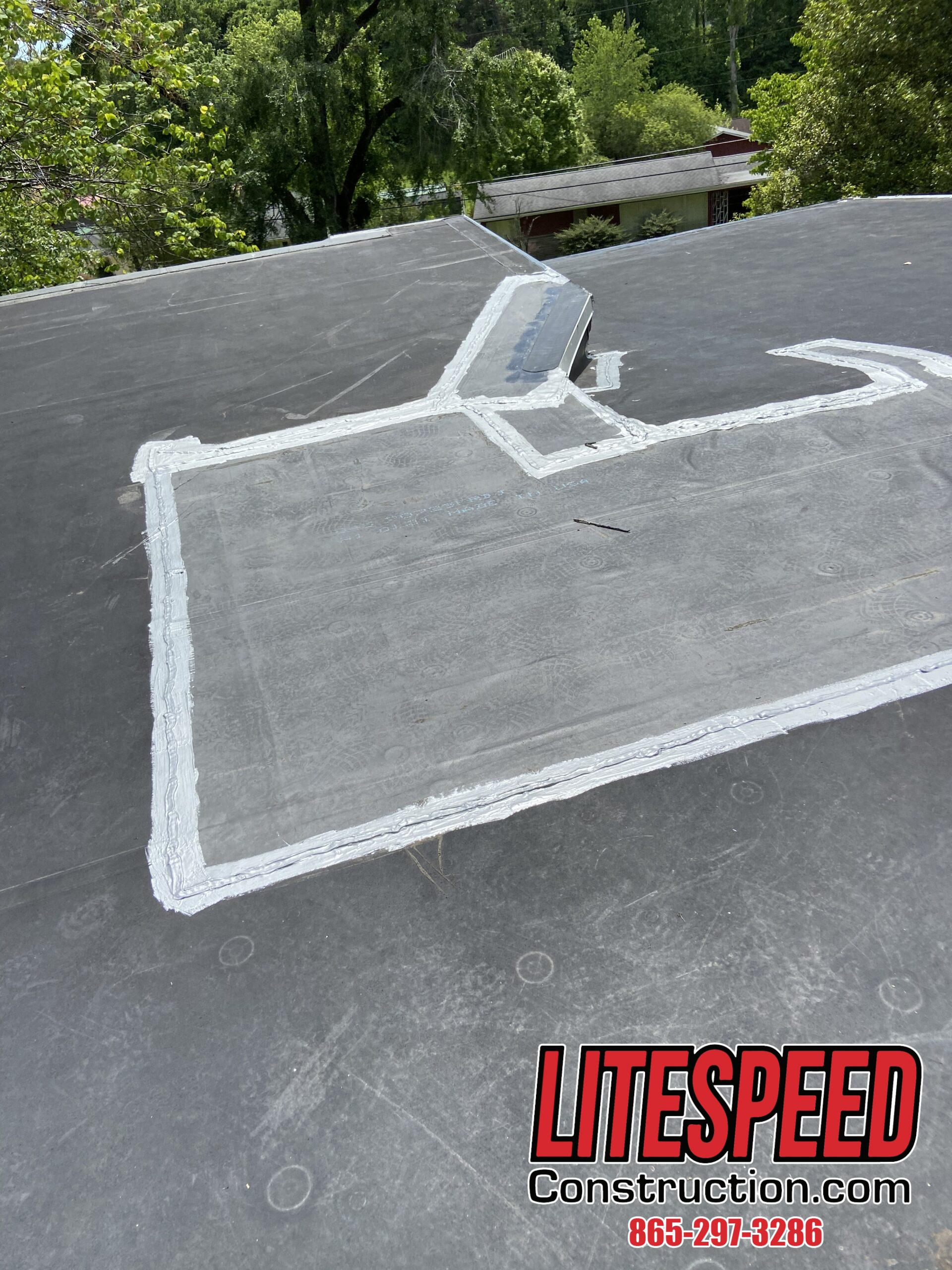 Roof coating around the perimeter of a membrane patch
