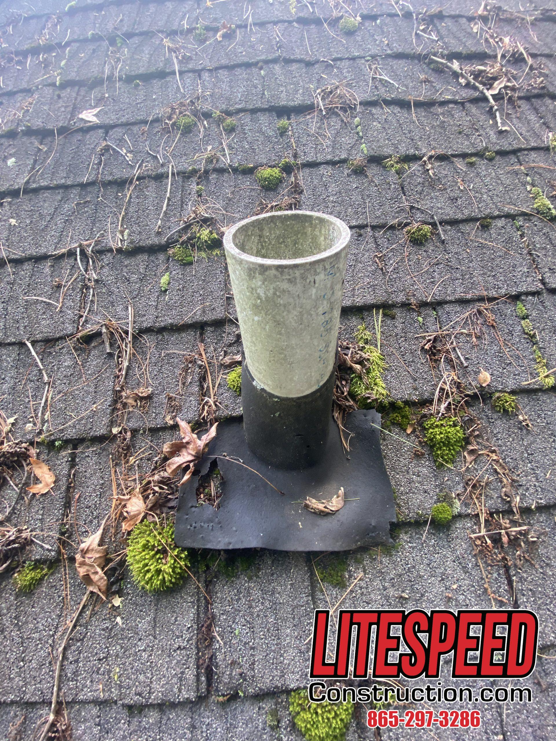 This is a picture of a black plastic pipe boot that has deteriorated