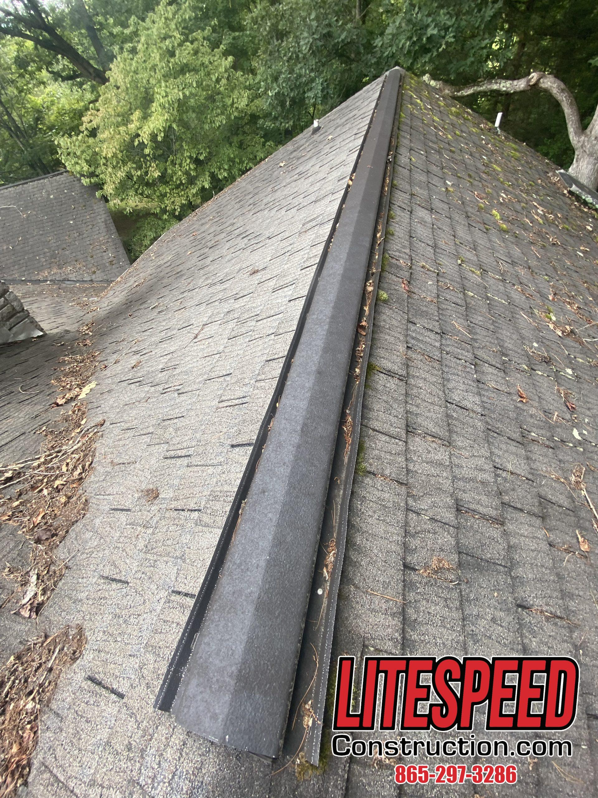 THis is a picture of an old black metal ridge vent
