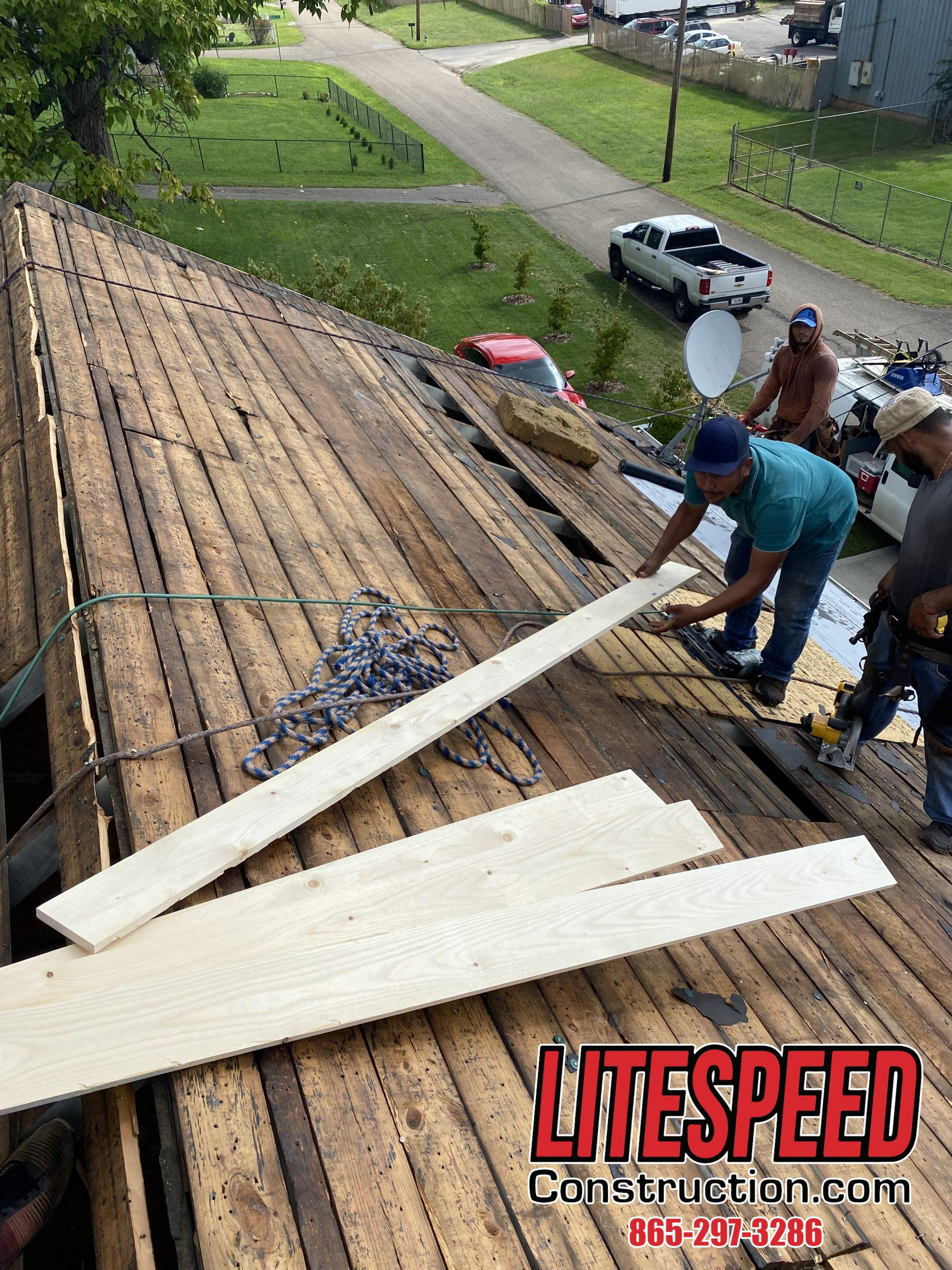 This is a picture of the roofing crew replacing pieces of wood