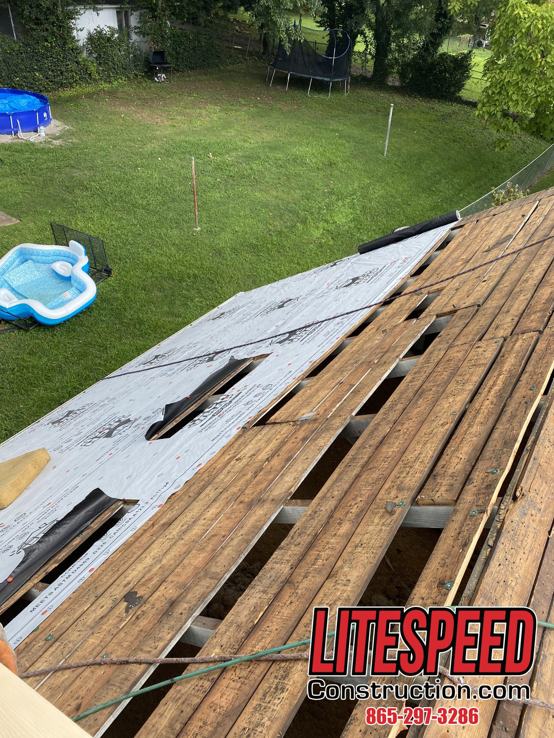 This is a picture of a roof that is getting synthetic underlayment