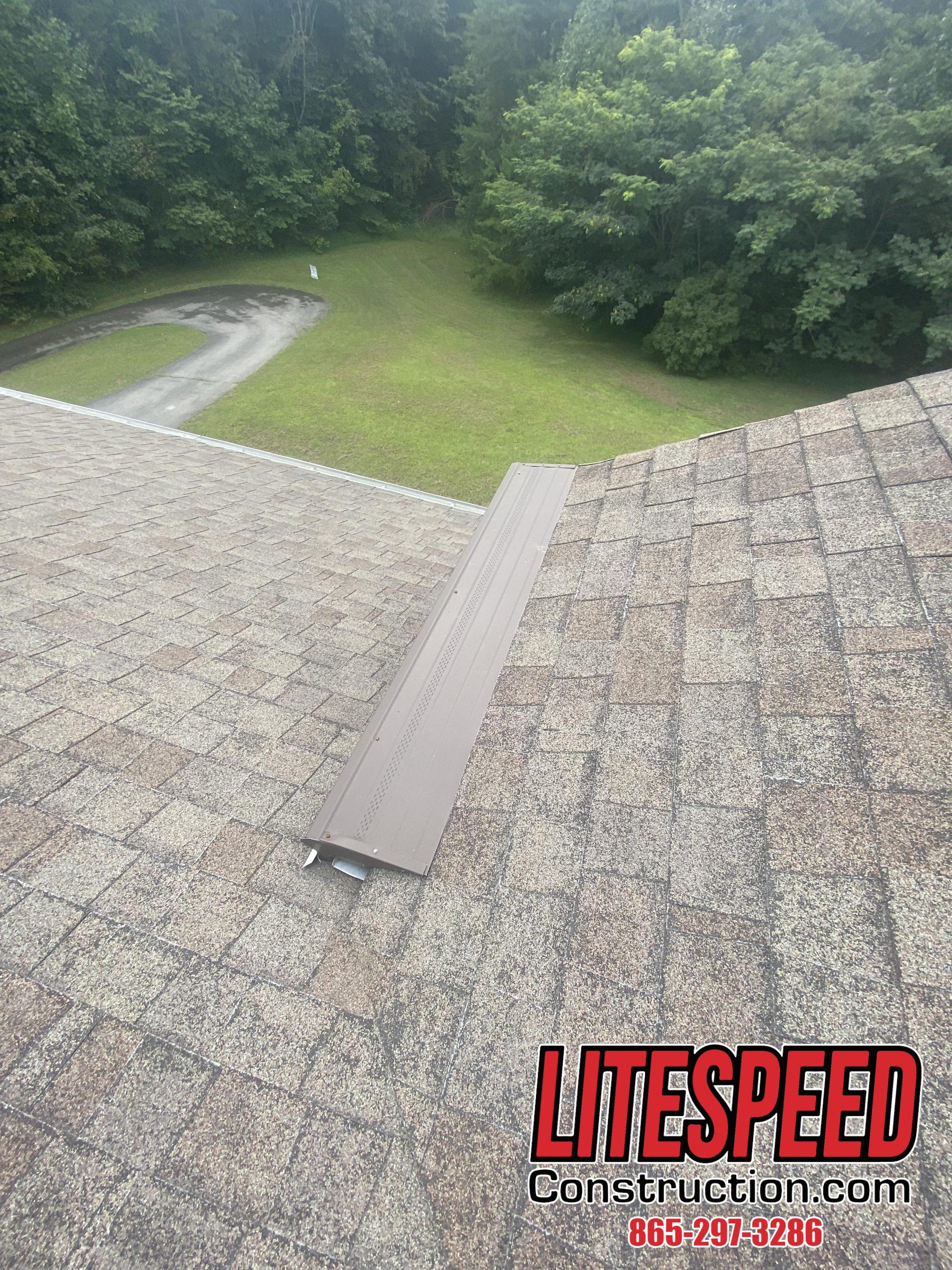 This is a picture of gutters with brown metal gutter guards