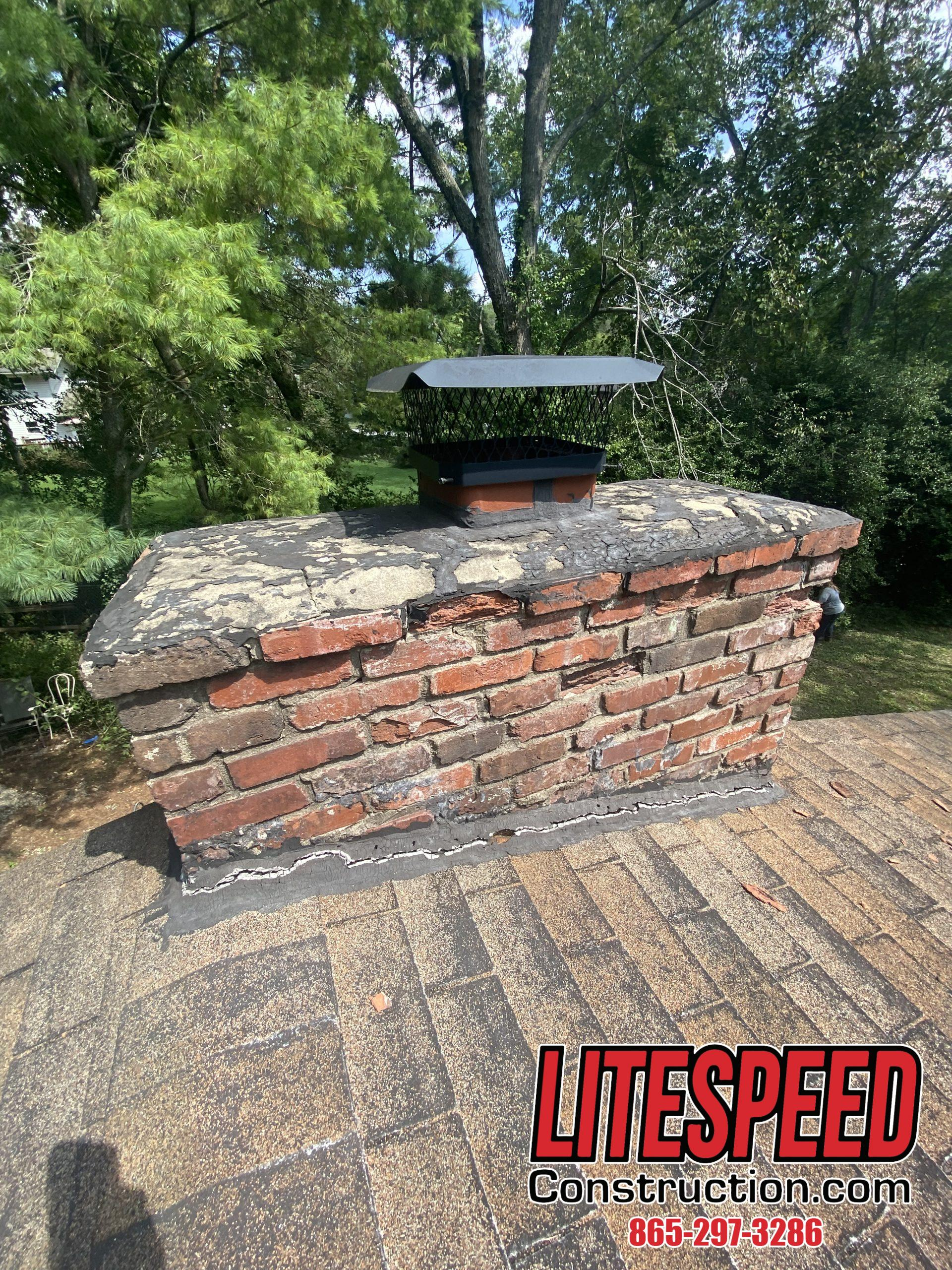 This is a picture of a brick chimney with bad flashing