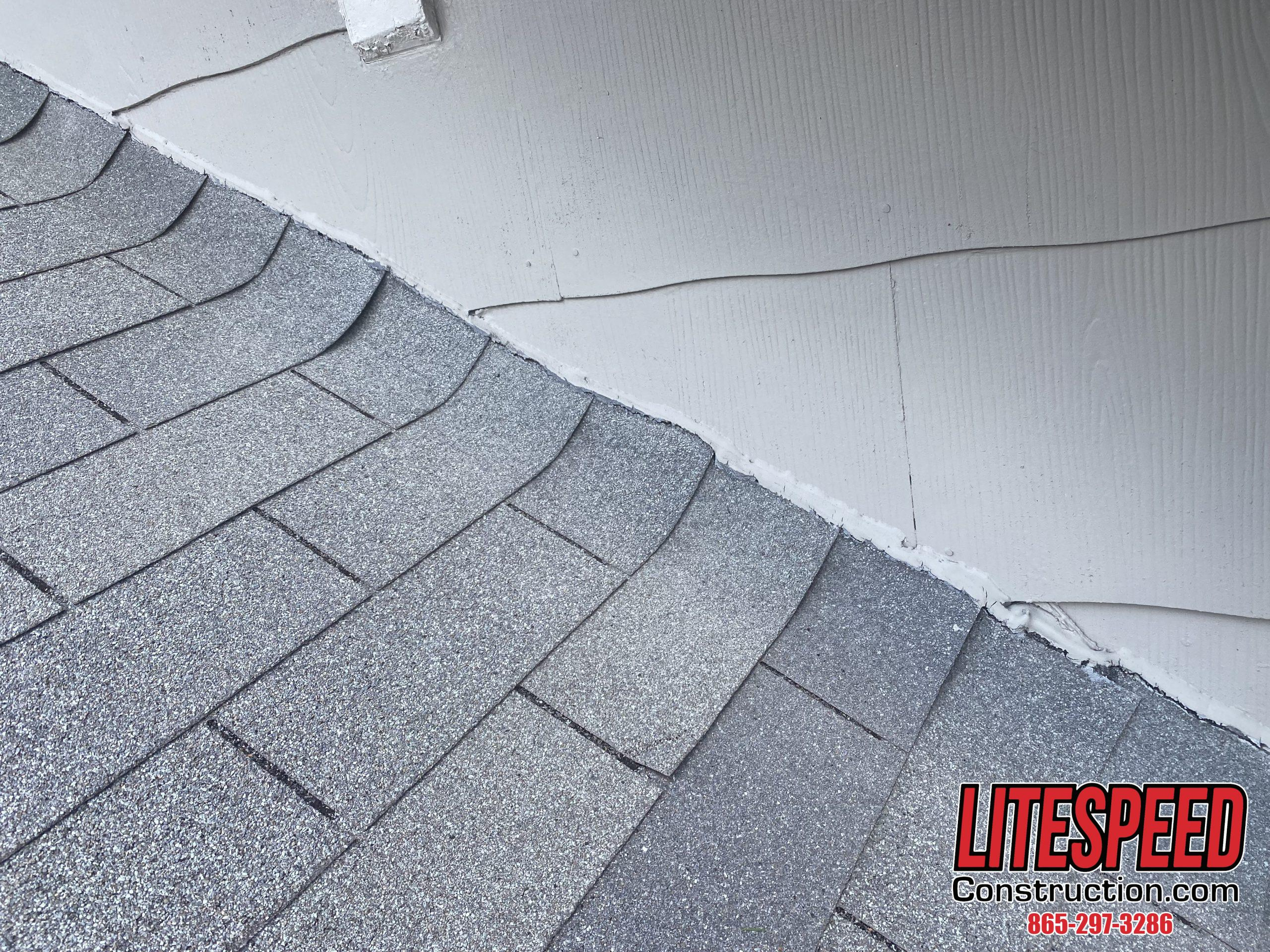 this is a. Picture of an old gray three tab roof with no flashing