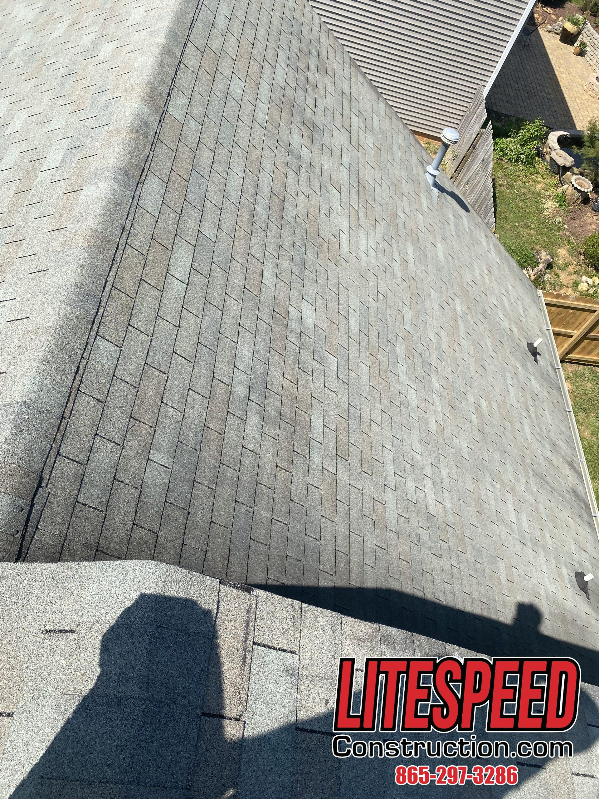 This is a picture of an old gray three tab shingle on a roof
