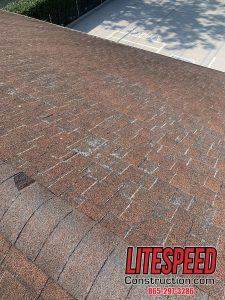 Here is the main issue with this roof and you can see clearly that the edges of the shingles are showing the fibers