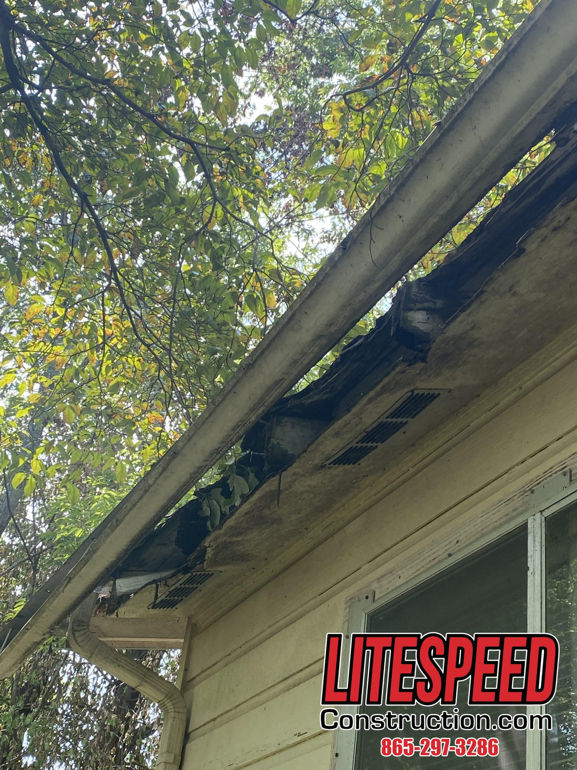 This is a picture of a gutter that is falling off the house