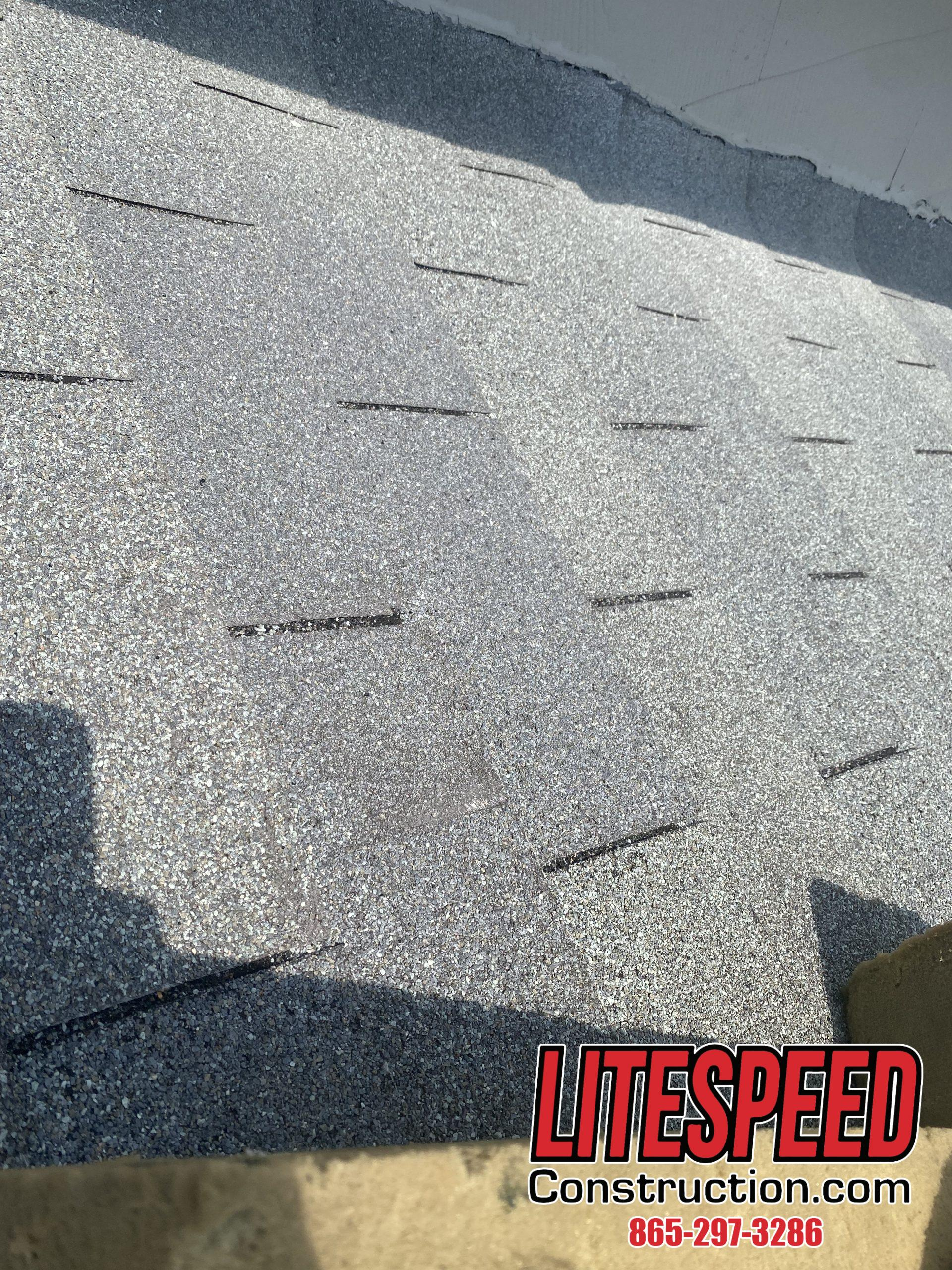 This is a picture of an old gray three tab roof in Knoxville tn