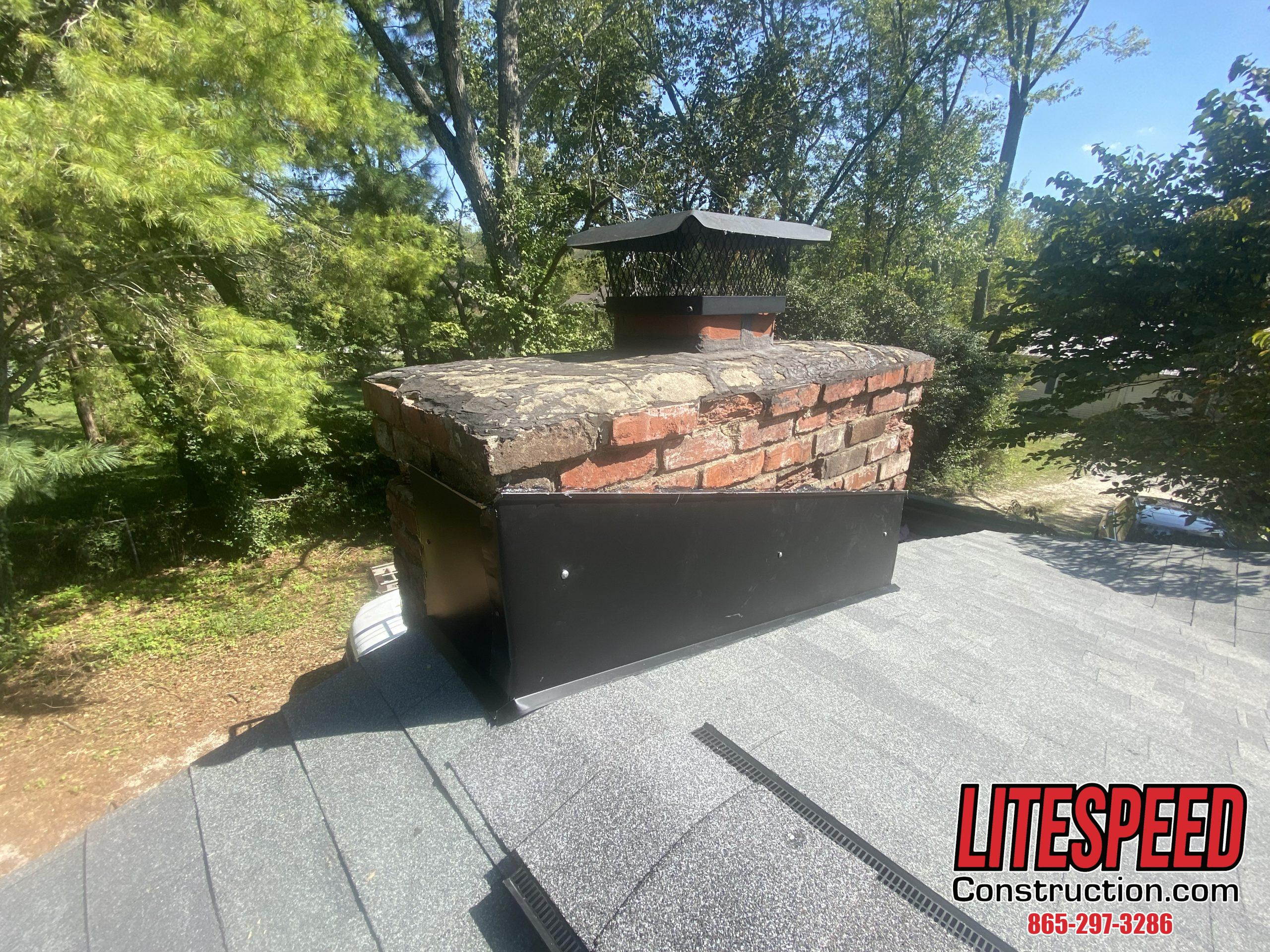 This is a picture of a brick chimney with new falshing